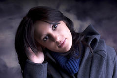 Beatiful young women holding here hair Royalty Free Stock Images
