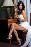 Beatifull bride with phone Royalty Free Stock Image