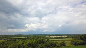 Beatifull grass field, country summer dark stormy clouds background. Aerial view of Beatifull grass field. Flying with drone above country field with dark stormy stock video footage