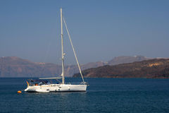Beatifull Yaht in Aegean Sea. With mountains and blue sky in the background Stock Photo