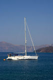Beatifull Yaht in Aegean Sea. With mountains and blue sky in the background Stock Photography