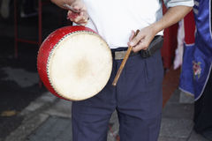 Beating a drum Royalty Free Stock Photo