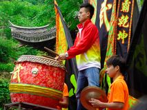 Beating a gong and drum for Lion dance performance Royalty Free Stock Photography