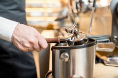Taking off a remains of coffee. Beating handle of a professional coffee machine taking off a remains of coffee stock photo