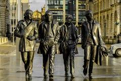 Beatles的雕象在利物浦` s江边,英国的 免版税库存图片