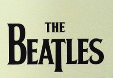 The Beatles logo. LONDON, UK - CIRCA APRIL 2016: Logo of British band The Beatles printed on a cd Royalty Free Stock Image
