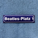 Beatles-Platz. Street sign of Beatles Square at the corner of Reeperbahn and Große Freiheit, in the middle of the infamous red light district of Hamburg Royalty Free Stock Images