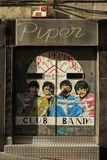 The Beatles pop art portraits. SALAMANCA, SPAIN - CIRCA JUNE 2015: The Beatles dressed in Sgt Pepper`s uniforms, reproduced on a night club door, with graffiti Stock Photos