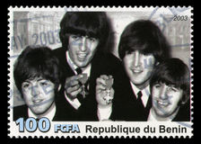The Beatles Postage Stamp from Benin. REPUBLIQUE DU BENIN - CIRCA 2003: A postage stamp portraying an image of The Beatles, circa 2003 Royalty Free Stock Images