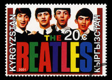 Beatles Postage Stamp from Kyrgyzstan. KYRGYZSTAN - CIRCA 2001: A Postage stamp from Kyrgyzstan portraying an image of The Beatles, circa 2001 Stock Photos