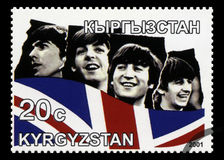 Beatles Postage Stamp from Kyrgyzstan. KYRGYZSTAN - CIRCA 2001: A Postage stamp from Kyrgyzstan portraying an image of The Beatles, circa 2001 Royalty Free Stock Photos