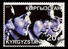 Beatles Postage Stamp from Kyrgyzstan. KYRGYZSTAN - CIRCA 2001: A Postage stamp from Kyrgyzstan portraying an image of The Beatles, circa 2001 Stock Images