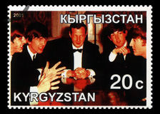 Beatles Postage Stamp from Kyrgyzstan. KYRGYZSTAN - CIRCA 2001: A Postage stamp from Kyrgyzstan portraying an image of The Beatles with their manager Brian Stock Photography