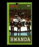 Beatles Postage Stamp from Rwanda. RWANDA, AFRICA - CIRCA 2009: A postage stamp from Rwanda portraying an image of The Beatles, circa 2009 Royalty Free Stock Photos