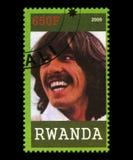 Beatles Postage Stamp from Rwanda. RWANDA, AFRICA - CIRCA 2009: A postage stamp from Rwanda portraying an image of George Harrison of The Beatles, circa 2009 Royalty Free Stock Images