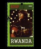 Beatles Postage Stamp from Rwanda. RWANDA, AFRICA - CIRCA 2009: A postage stamp from Rwanda portraying an image of John Lennon of The Beatles, circa 2009 Royalty Free Stock Image