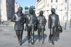 Beatles statue at the liverpool waterfront. Bronze statue of the four Liverpool Beatles stands on Liverpool waterfront by sculptor Andrew Edwards Stock Image