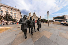 Beatles statue at the Liverpool Waterfront. LIVERPOOL, UK - AUGUST 18, 2016:  Bronze statue of the four Liverpool Beatles stands on Liverpool Waterfront by Stock Images