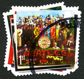 The Beatles UK Postage Stamp. GREAT BRITAIN - CIRCA 2007: A used postage stamp from the UK, depicting the album cover of Sgt Peppers Lonely Hearts Club Band by Royalty Free Stock Images