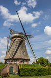 Beatrix mill in Winssen against a blue sky Royalty Free Stock Photos