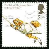 Beatrix Potter UK Postage Stamp. GREAT BRITAIN - CIRCA 2006: A used postage stamp from the UK, depicting an illustration from The Tale of Mr. Jeremy Fisher by Stock Photos
