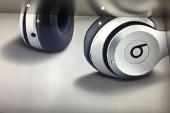 Beats Earphones, Store. NEW YORK, UNITED STATES AMERICA - FEB 23 2016: Beats earphones displaying on a poster inside Apple Store, New York, USA stock photo