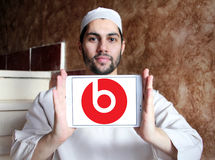 Beats Electronics logo. Logo of Beats Electronics company on samsung tablet holded by arab muslim man. Beats Electronics is a subsidiary of Apple Inc. that Royalty Free Stock Photography