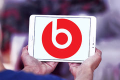 Beats Electronics logo. Logo of Beats Electronics company on samsung tablet. Beats Electronics is a subsidiary of Apple Inc. that produces audio products and was Royalty Free Stock Images