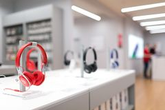 Beats EP headphones by Dr Dre in red color on the stand in electronic store. Belgrade, Serbia - March 21, 2018: New Beats EP headphones, by Dr Dre, in red color stock images