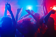 Beats in my body. Young people getting more and more uninhibited dancing stock photography