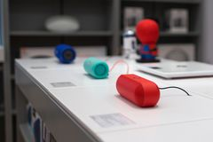 Beats Pill+ speakers in red color on the white table in electronic store stock photos