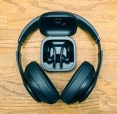 Beats Studio 3 Wireless and Powerbeats Pro Beats on table desk. Paris, France - Jun 17, 2019: Square image Beats Studio 3 Wireless and Powerbeats Pro Beats in by stock photo