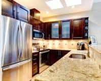 Beatufiful morern dark cabinet kitchen. Stock Images