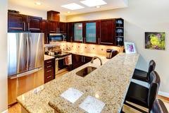 Beatufiful morern dark cabinet kitchen. Stock Image