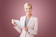 Beatuiful woman with tablet Royalty Free Stock Images
