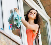 Beaty housewife cleaning windows with rag Stock Photos
