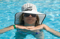 Beaty in sunglasses and white hat Stock Image