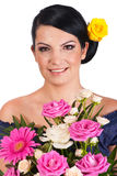 Beaty woman holding colorful flowers Royalty Free Stock Photography