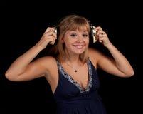 Beatyful girl with headphones. Listning music Royalty Free Stock Photo
