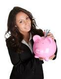Beau argent d'économie de jeune femme Photo libre de droits
