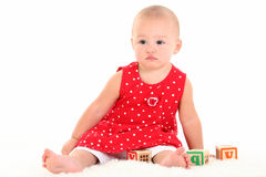 Beau bébé avec le dégagement de cigogne sur la languette supérieure Photographie stock libre de droits