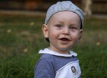 Beau bébé de sourire mignon heureux adorable expressif photos stock