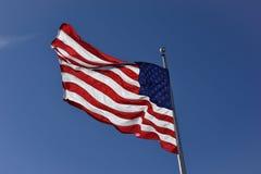 Beau battement de drapeau américain de bannière étoilée dans le vent Photos libres de droits