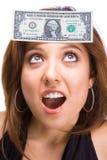 Beau Brunette avec le billet d'un dollar sur le visage Photos stock