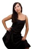 Beau brunette dans la robe noire Photographie stock