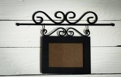 Beau cadre accrochant noir de photo Photographie stock libre de droits