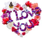 Beau coeur avec la légende faite de différentes fleurs Photographie stock libre de droits