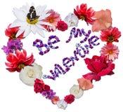 Beau coeur avec la légende faite de différentes fleurs sur b blanc Images libres de droits