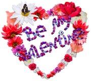 Beau coeur avec la légende faite de différentes fleurs sur b blanc Photographie stock libre de droits
