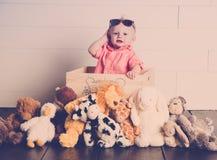 Beau com seus brinquedos do luxuoso imagem de stock royalty free